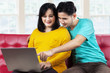 Husband and pregnant woman surfing internet