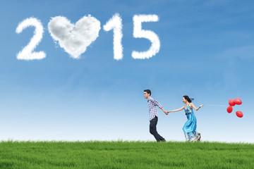 Lovers walking on meadow