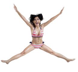 Joyful woman in sexy bikini
