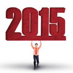 Hispanic person holds number 2015