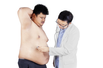 Overweight man checkup in hospital 2