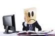 Sad businessman with cardboard head