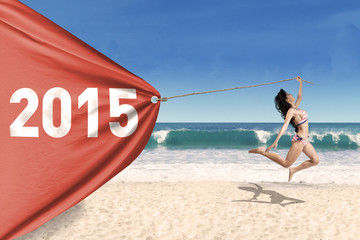 Pretty girl in bikini with banner new year