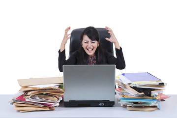 Stressful businesswoman screaming in office 2