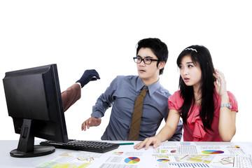 Shocked businesspeople looking hacker 2