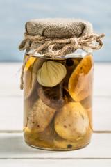 Wild mushrooms in vinegar in a jar