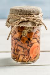 Wild mushrooms in a jar
