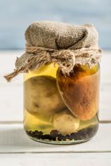With mushrooms in vinegar