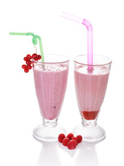 Glasses of raspberry and red currant smoothies