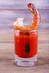 Fresh boiled prawns in a glass with tomato sauce
