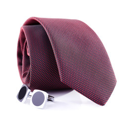 Brown tie and a pair f collar button