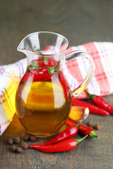 Homemade natural infused olive oil with red chili peppers and