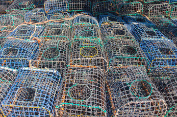 Some fishing cages stacked on the ground