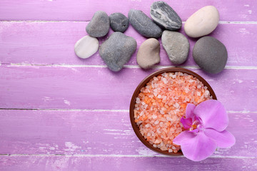 Still life with beautiful blooming orchid flower, sea salt and