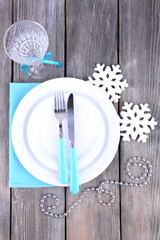 White plates, fork, knife, goblet and Christmas tree decoration