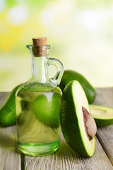 Avocado oil on table on light background