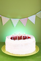 Cake on green background