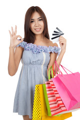 Beautiful Asian woman show OK sign with many credit cards