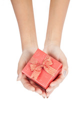 Top view of red gift box with red ribbon in hand
