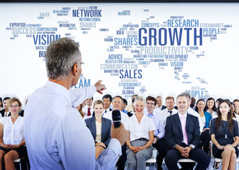 People Listening to a Business Presentation