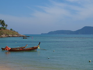 longtail boats in bay of Phuket island, Thailand.