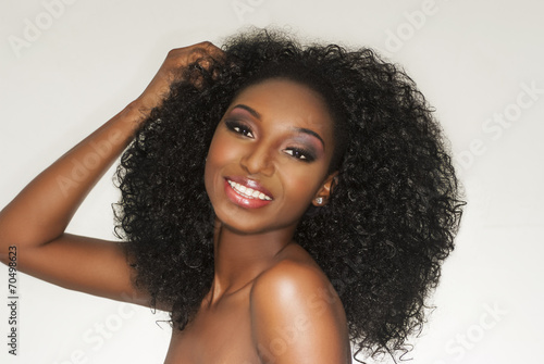 Beautiful Happy Woman In Curly Hair Portrait - 70498623