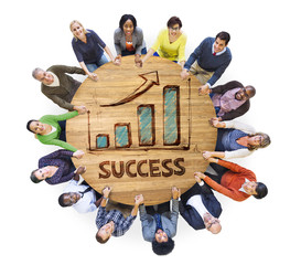 People around Wooden Table with Success Chart