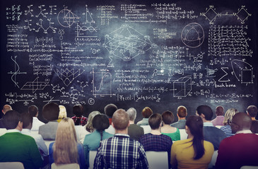 Multiethnic Group of People with Formula on Chalkboard