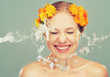 beauty laughing girl with splashes of water and yellow flowers - 70499436