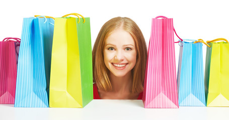 happy woman with bag on a shopping isolated
