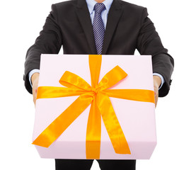 Businessman holding a gift box. isolated on white