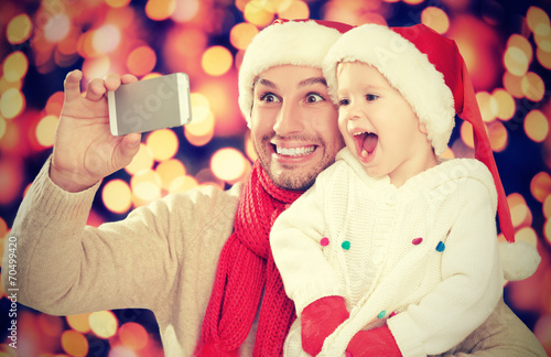 canvas print picture selfe  in Christmas. happy family dad with daughter