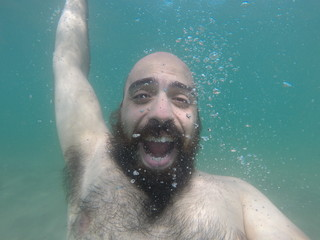 underwater man in summer happy