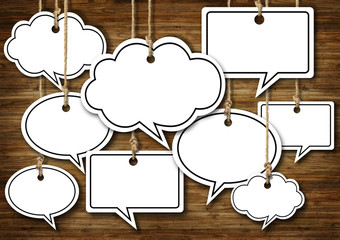 Speech Bubbles Hanging on Wooden Background