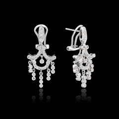 White gold earrings isolated on the black background
