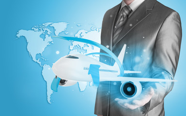 Businessman with airplane over his hand