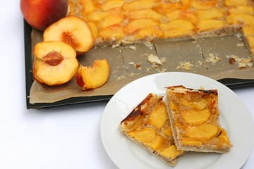 Delicious homemade summer dessert: peach pie with puff pastry