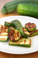 Sliced grilled zucchini on a plate