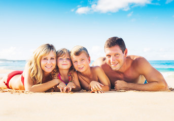 Family of Four on Tropical Beach