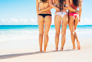 Three Girls in Sexy Bikinis on the Beach