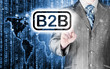 businessman pointing to word B2B