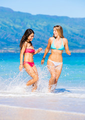 Two Beautiful Young Girls on the Beach
