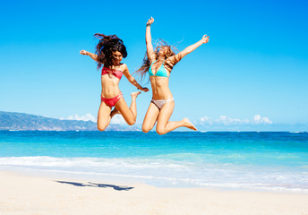 Beautiful Girls Jumping on the Beach
