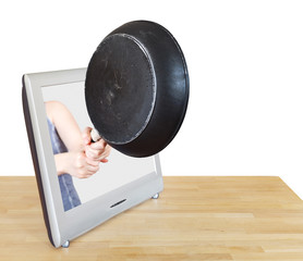 woman with frying pan leans out TV screen