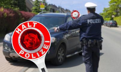 Polizist mit Anhaltestab