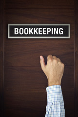 Businessman knocking on Bookkeeping office door