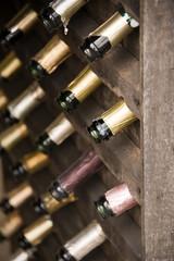 Wooden wine rack with empty bottles