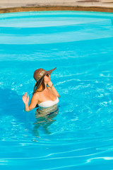 Woman relaxing at the swimming pool