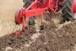 A Vintage Plough Cutting a Deep Furrow in a Field.