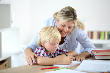 Mom helping little boy to do homework
